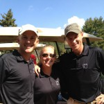 paul ellis, partner, cpa is standing with brandi and rob clouser at the golf tournament fundraiser