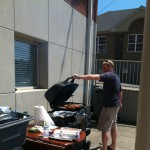 BBQ at thurman campbell group for employee appreciation jeff henley cpa cooking on grill